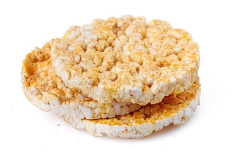 Gekarameliseerde graancakes Gepuft geheel die korrelknäckebrood op witte achtergrond wordt geïsoleerd Close-up stock afbeelding