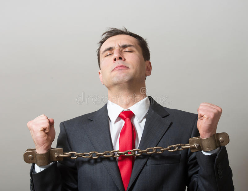 Geketende zakenman stock afbeelding