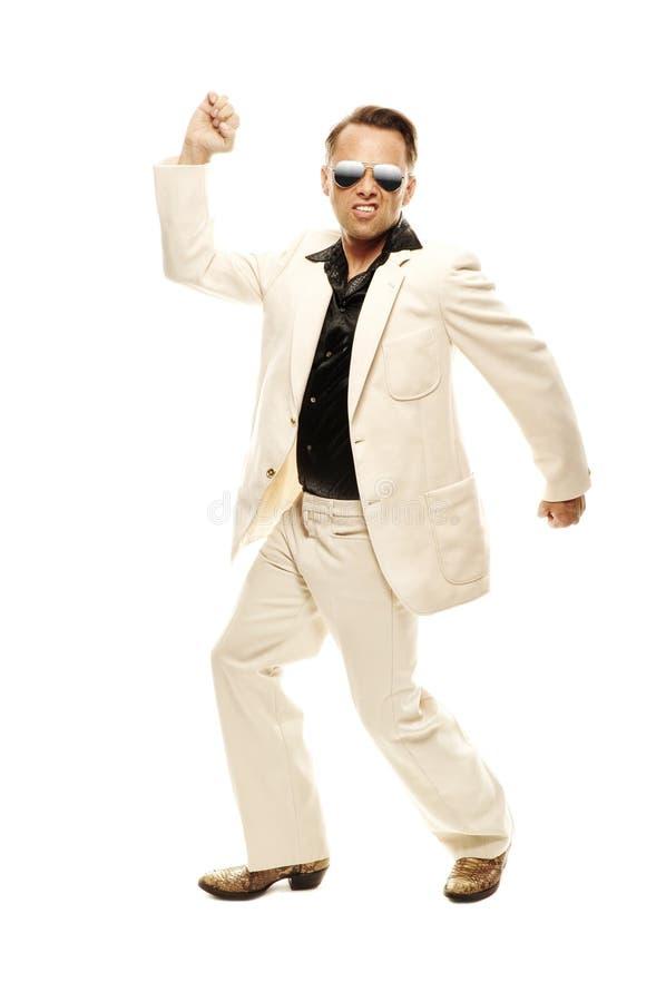 Gekke discodanser in witte kostuum en slangleerlaarzen royalty-vrije stock fotografie