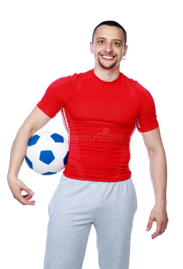 Gekke sportieve het voetbalbal van de mensenholding stock fotografie