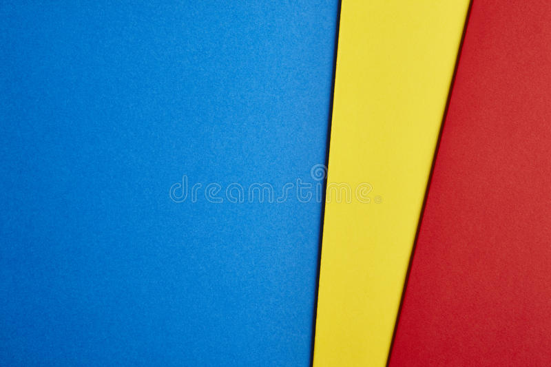 Gekleurde cardboardsachtergrond in blauwe gele rode toon Exemplaar Spac royalty-vrije stock fotografie