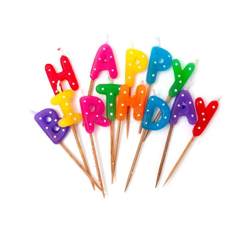 Gekleurde die verjaardagskaarsen op wit worden geïsoleerd royalty-vrije stock foto's