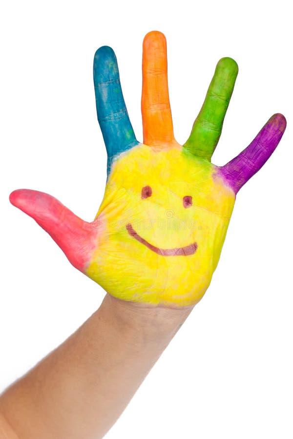 Gekleurde hand met glimlach royalty-vrije stock foto