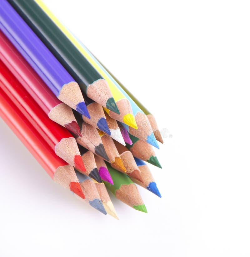 Gekleurde potloden op wit royalty-vrije stock afbeelding