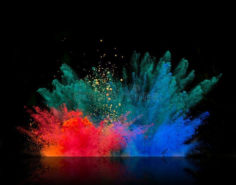 Gekleurde stofexplosie op zwarte achtergrond royalty-vrije stock foto's