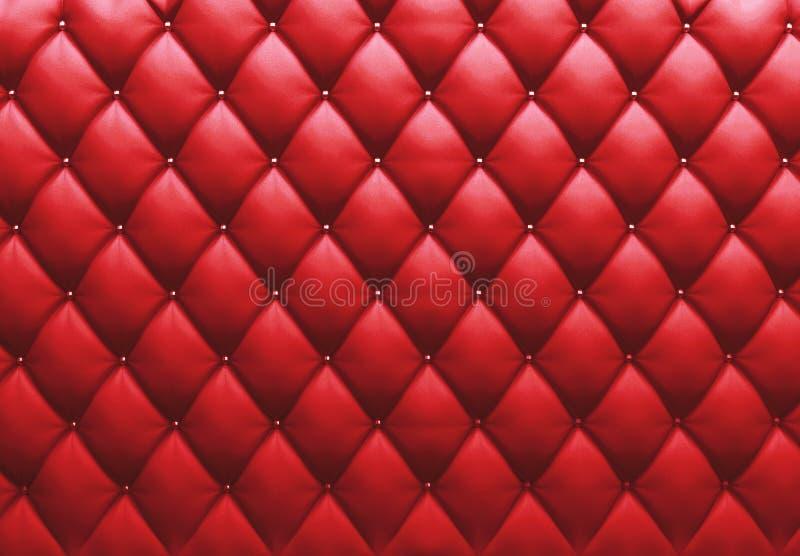 Geknöpft auf der roten Beschaffenheit. Wiederholen Sie Muster