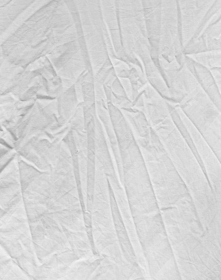 Geknitterter weißer Stoff als Hintergrund lizenzfreie stockfotografie