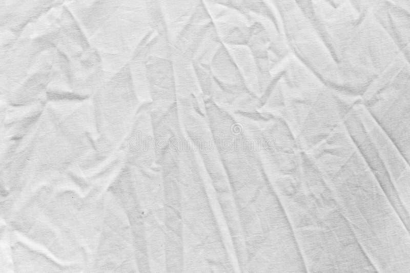 Geknitterter weißer Stoff als Hintergrund lizenzfreie stockbilder
