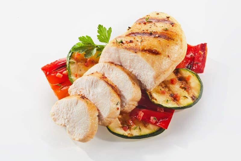 Gekochtes und geschnittenes Huhn mit Zucchini lizenzfreie stockfotos