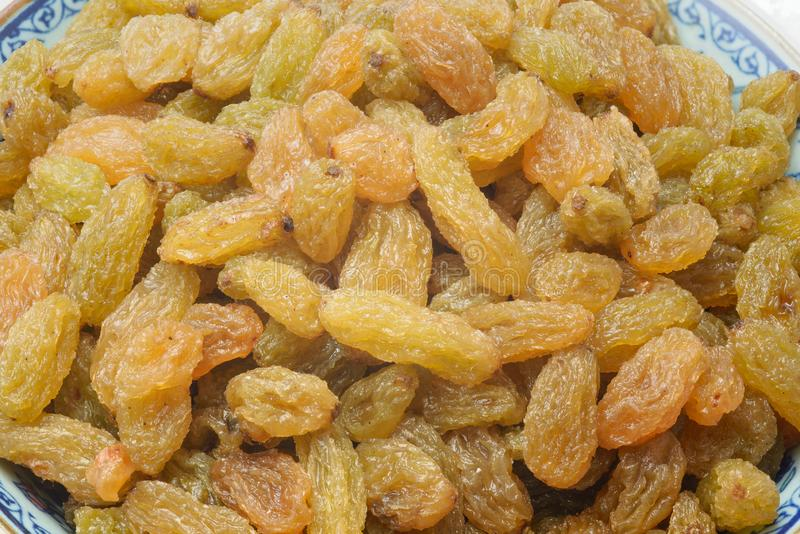 Gekonfijte vrucht of gekristalliseerd fruit van gouden rozijnen stock afbeelding
