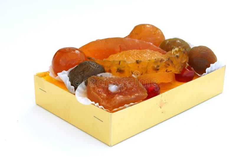 Gekonfijte vruchten in doos royalty-vrije stock afbeeldingen