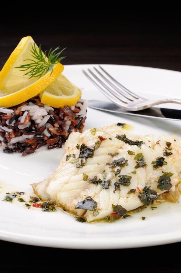 Gekookte vissen met rijst stock foto's