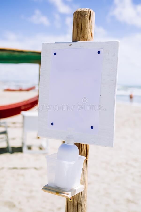 Gel dispenser anticovid 19 in a beach in italy stock photography