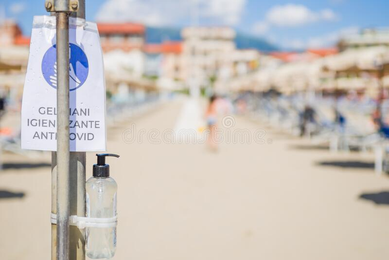 Gel dispenser anticovid 19 in a beach in italy stock images