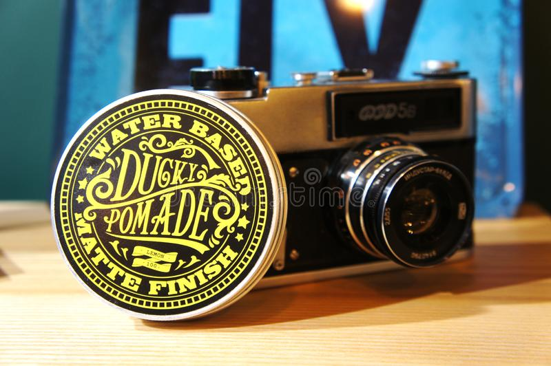 Gel for male hair styling. pomade water based, matte finish. trendy barbershop styling stock photography