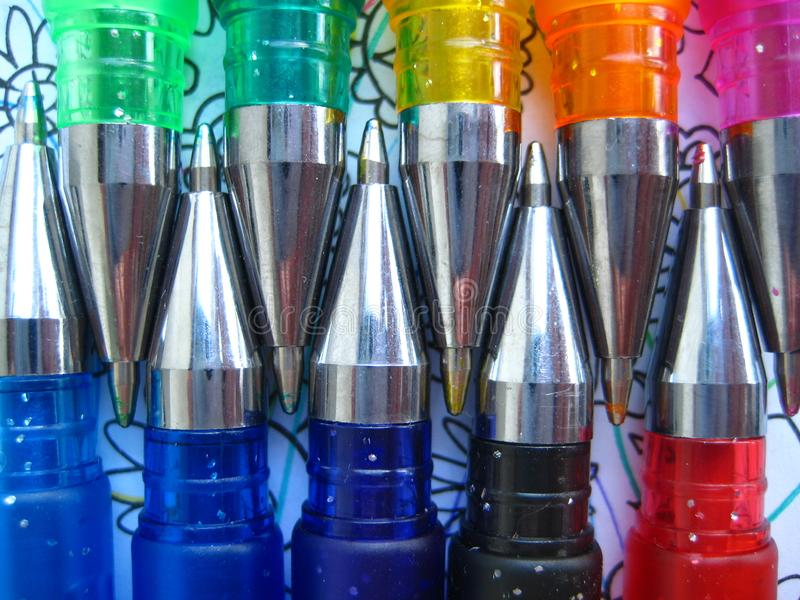 Gel pens close-up. Multicolored gel pens, piled with beautiful pattern royalty free stock photos