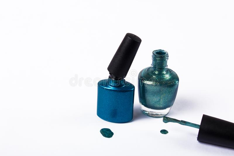 Gel Polish for manicure on a white background isolated, with space. Scattered nail Polish in the beauty salon. The choice of color stock photos