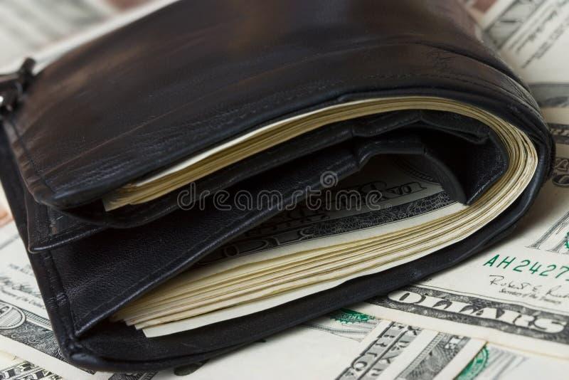 Geladen Portefeuille stock afbeeldingen