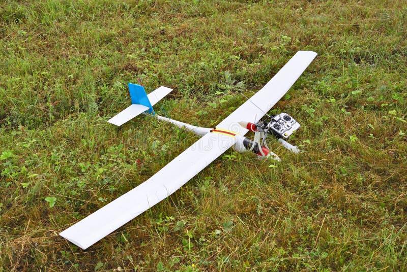 Gelande het model van het vliegtuig stock afbeeldingen
