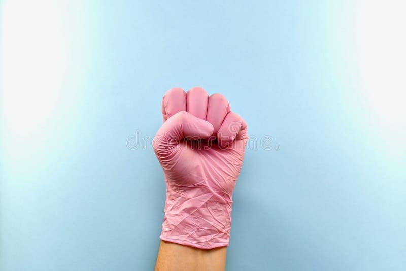 Gelassene Hand zusammengepreßt in eine Faust, behandschuht stockbild