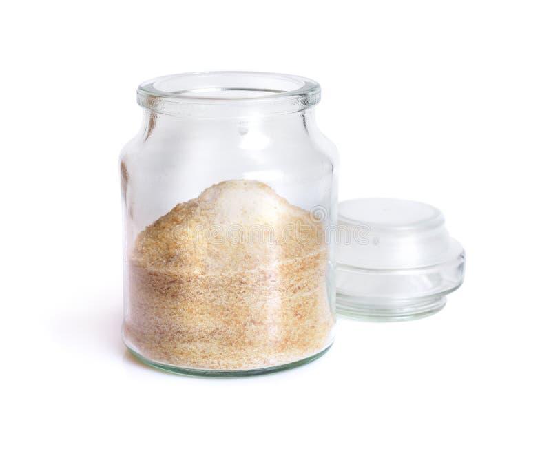 Gelatin or gelatine in the glass jar. On white background. Gelatin or gelatine in the glass jar. On white background stock photos