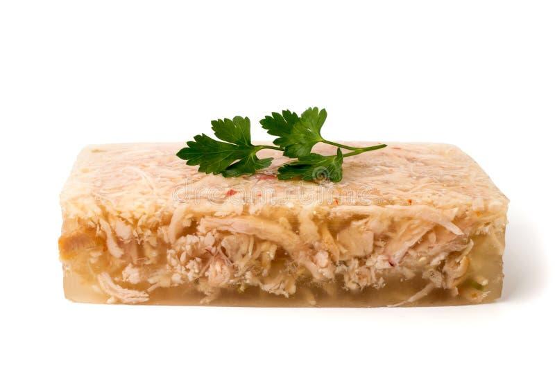 Gelatina della carne con prezzemolo su un bianco fotografia stock libera da diritti