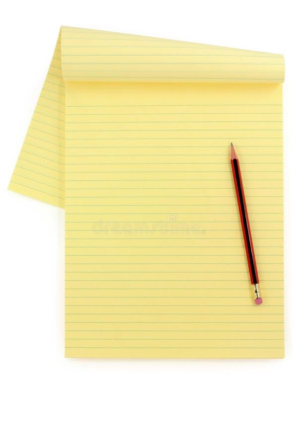 Gelb gezeichnetes Papier und Bleistift lizenzfreie stockfotografie