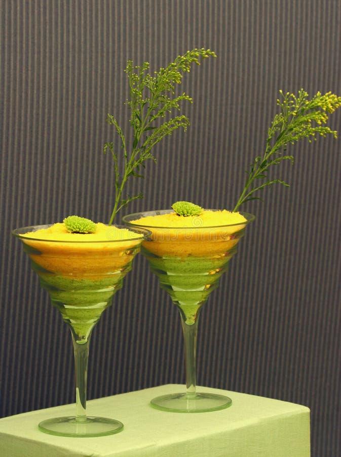 Gelb und Kalk-schrullige Cocktails lizenzfreie stockbilder