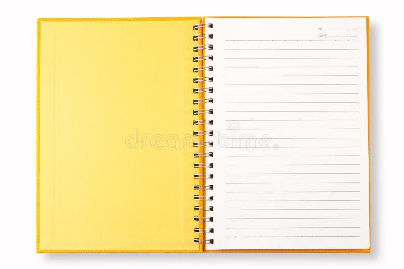 Gelbe Abdeckung des geöffneten Anmerkungs-Buches stockfoto