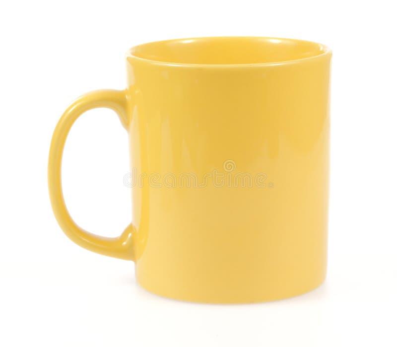 Gelbe Becherschale für Kaffeeteewasser stockbild