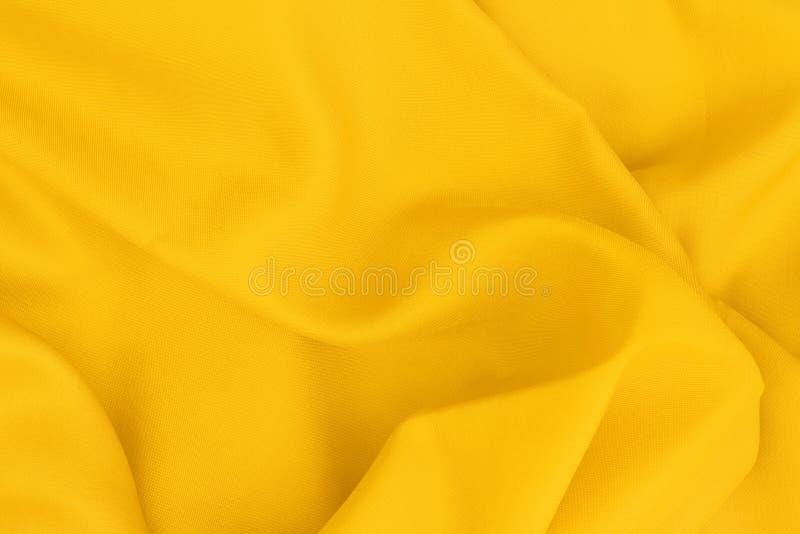 Gelbe Gewebebeschaffenheit für Hintergrund- und Entwurfskunstwerk, schönes Muster der Seide oder Leinen lizenzfreies stockfoto