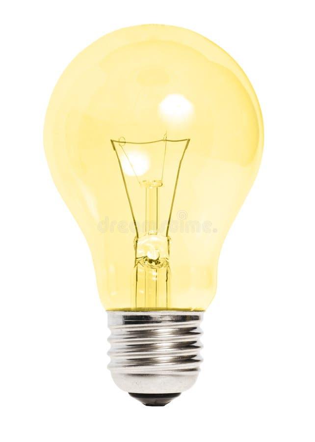 Gelbe Glühlampe getrennt stockfotos