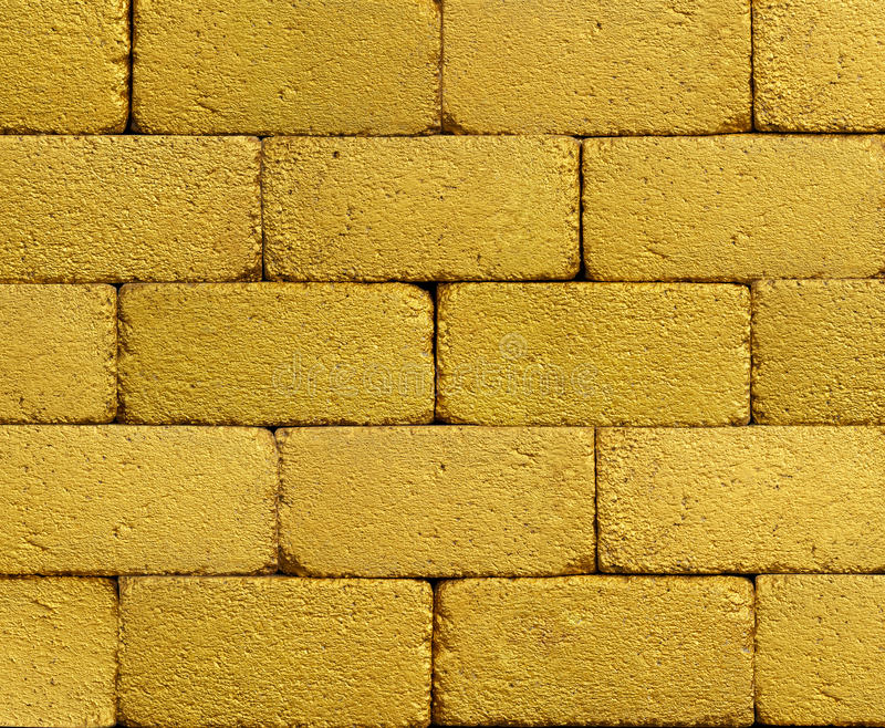 Gelbe goldene Backsteinmauer lizenzfreie stockbilder