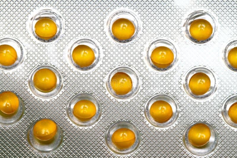 Gelbe Pillen stockbild