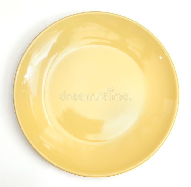 Gelbe Platte. getrennt stockbilder