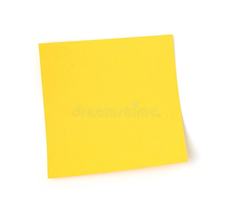 Gelbe Post-Itpapieranmerkung über weißen Hintergrund lizenzfreie stockfotografie