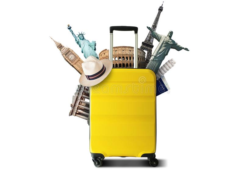Gelbe Reisetasche mit Weltmarkstein stockbilder