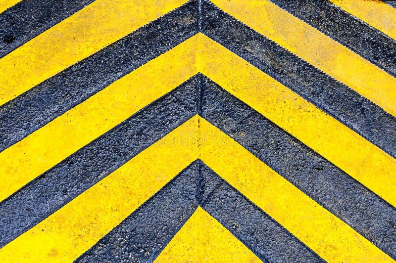 Gelbe Richtungspfeile stockfoto