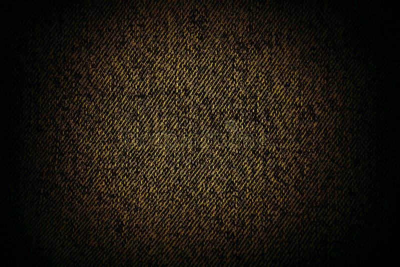 Gelbe schwarze Segeltuchbeschaffenheit oder -hintergrund lizenzfreie stockfotos