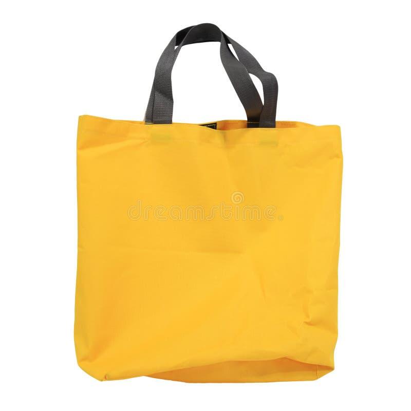 Gelbe Segeltucheinkaufstasche lokalisiert auf Weiß stockfotos