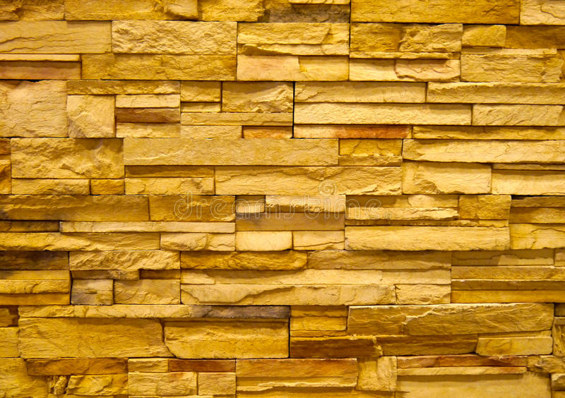 Gelbe Steinblockwand stockfoto
