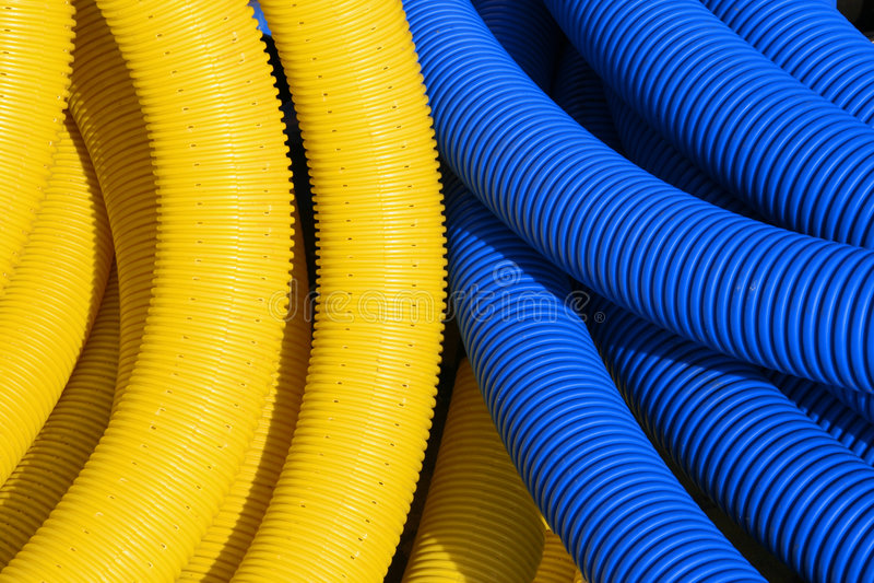Gelbe und blaue Rohre lizenzfreie stockfotos