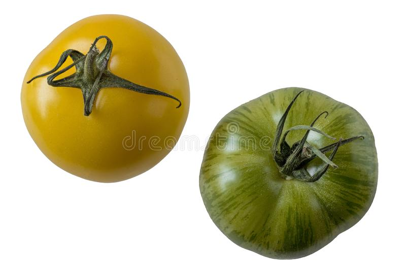 Yellow and green tomato varieties, isolated stock photo