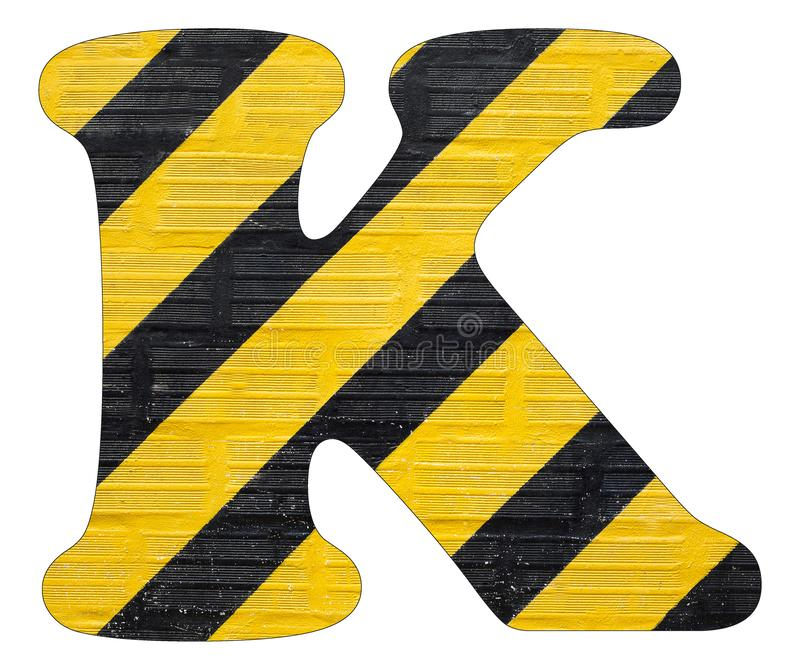 Gelbe und schwarze Linien des Buchstaben K - Weißer Hintergrund stockfotos