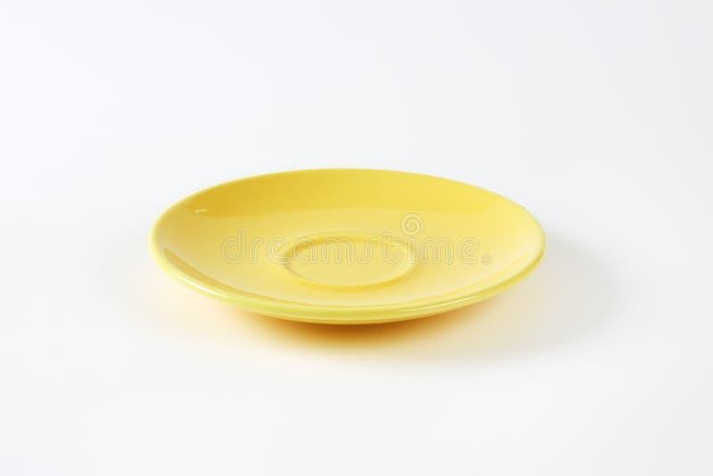 Gelbe Untertasse stockfotografie