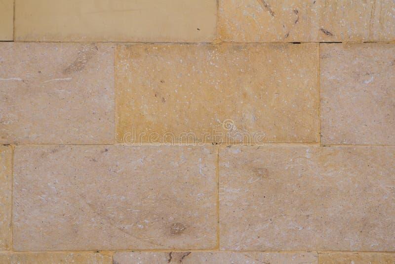 Gelber Backsteinmauersandstein lizenzfreie stockfotografie