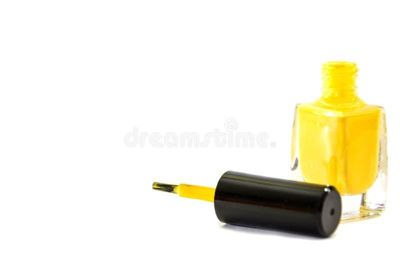 Gelber Nagellack auf einem weißen Hintergrund lizenzfreies stockbild