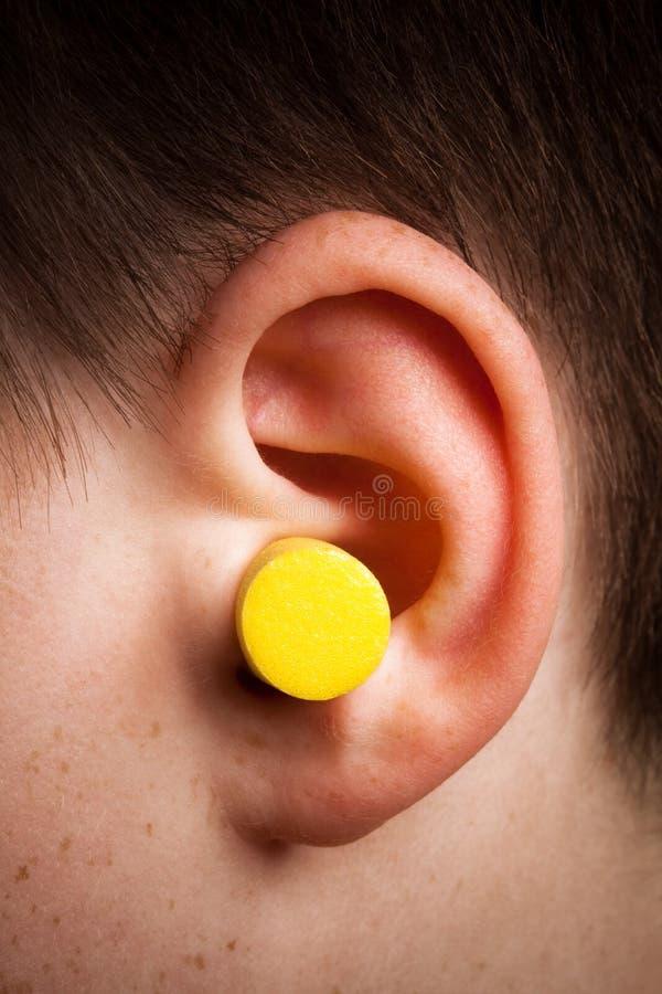 Gelber Ohrenpfropfen stockbild