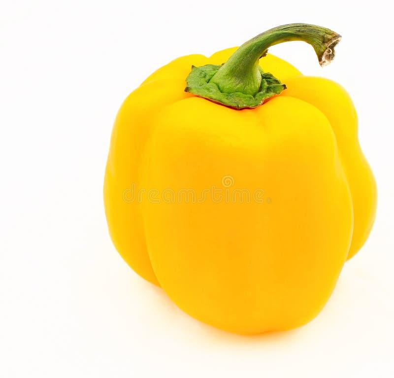 Gelber Pfeffer auf weißem Hintergrund lizenzfreie stockfotos