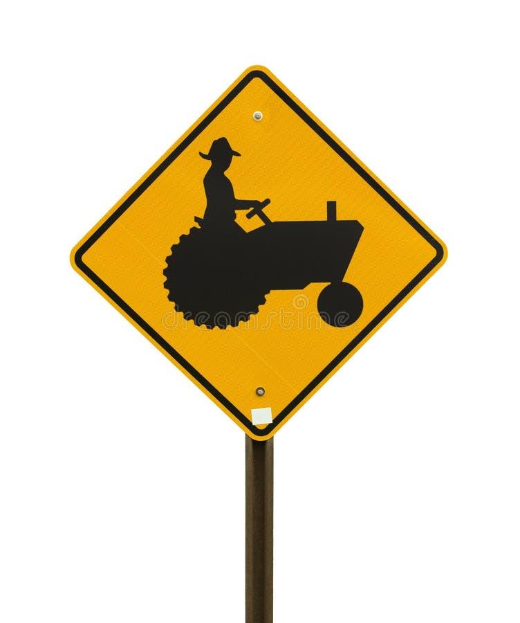 Gelbes Bauernhoftraktorzeichen stockfotos